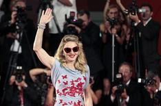 "<p>Pop star and director Madonna arrives on the ""W.E"" red carpet at the 68th Venice Film Festival in Venice September 1, 2011. REUTERS/Alessandro Bianchi</p>"