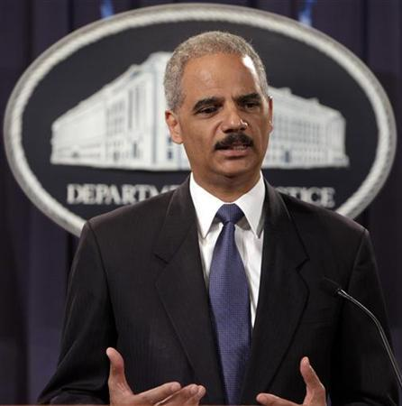 U.S. Attorney General Eric Holder holds a news conference to deliver the results to date of the largest prosecution of an international criminal network organized to sexually exploit children, at the Justice Department in Washington August 3, 2011. REUTERS/Yuri Gripas
