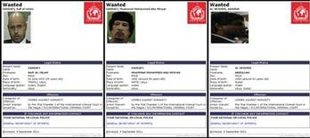 Скриншоты с сайта Интерпола, выдавшего международные ордеры на арест Муаммара Каддафи (в центре), Саифа аль-Ислама Каддафи (слева) и Абдуллы аль-Сенусси (справа), 9 сентября 2011 года. Интерпол выдал ордеры на арест экс-лидера Ливии Муаммара Каддафи, его сына Саифа аль-Ислама и бывшего шефа разведки североафриканской страны Абдуллы аль-Сенусси, говорится в заявлении организации, распространенном в пятницу. REUTERS/Interpol/Handout