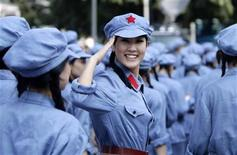 <p>A performer dressed in Red Army uniform salutes at a revolutionary song singing event to celebrate the upcoming 90th anniversary of the founding of the Communist Party of China (CPC), in Chongqing municipality, June 28, 2011. REUTERS/Jason Lee</p>