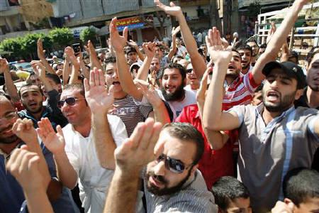 Lebanese and Syrian demonstrators chant slogans while gesturing as they march during a protest in solidarity with Syria's anti-government protesters, in Tripoli, northern Lebanon September 16, 2011. REUTERS/ Omar Ibrahim