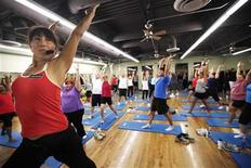 <p>Trainer Anne Marie Smith (L) leads guests in a Pilates workout before dawn at the Biggest Loser Resort in Ivins, Utah September 6, 2010. REUTERS/Rick Wilking</p>