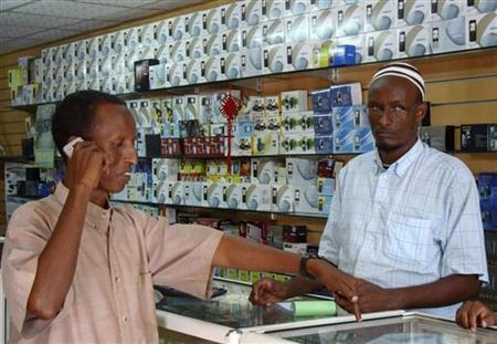 A Somali resident purchases a cell-phone handset at a shopping centre in Mogadishu, November 4, 2009. REUTERS/Feisal Oma