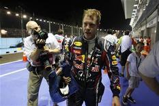 O piloto da Red Bull Sebastian Vettel após segunda sessão de prática para o Grande Prêmio de Cingapura. 23/09/2011 REUTERS/David Loh