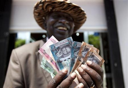 A Man From South Sudan Displays New Currency Notes Outside The Central Bank Of In Juba July 18 2017 Reuters Benedicte Desrus