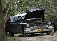 <p>A man services his 1956 Cadillac Fleetwood car which he uses as a private taxi in Havana February 13, 2011. REUTERS/Desmond Boylan</p>