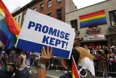 <p>A participant in the Gay Pride Parade holds a sign reading, 'Promise Kept!' in reference to the recent legalization of gay marriage as they march past the Stonewall Inn in New York June 26, 2011. REUTERS/Jessica Rinaldi</p>