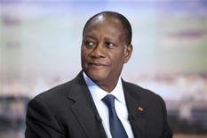 Ivory Coast President Alassane Ouattara appears on the French TF1 television prime time evening news show prior to an interview, September 13, 2011 in Paris.   REUTERS/Fred Dufour/Pool
