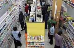 People shop in a supermarket in a file photo. REUTERS/Antony Njuguna