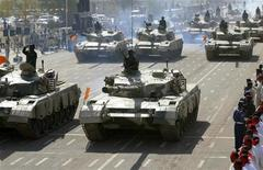 Sudanese military forces parade in their tanks during Independence Day celebrations in Khartoum, December 31, 2008. REUTERS/Mohamed Nureldin
