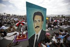 A boy holds a poster of Yemen's President Ali Abdullah Saleh during a weekly Friday prayers attended by Saleh's supporters in Sanaa September 30, 2011. REUTERS/Khaled Abdullah