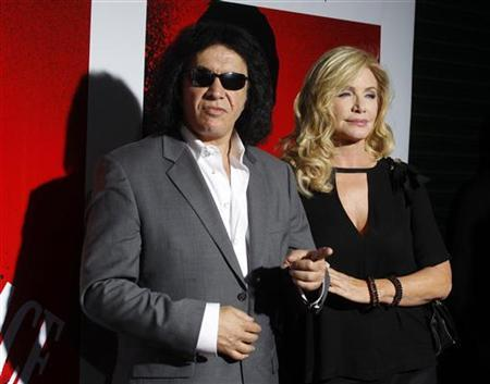 Gene Simmons of the band Kiss and actress Shannon Tweed arrive at the Blu-ray disc launch party for the 1983 classic film ''Scarface'' in Los Angeles, California August 23, 2011. REUTERS/Fred Prouser