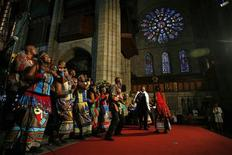 <p>Archbishop Desmond Tutu (2nd R) dances with members of the Soweto Gospel Choir during the launch of his autobiography in Cape Town, October 6, 2011. REUTERS/Mark Wessels</p>
