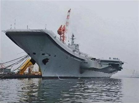 China's first aircraft carrier is seen at its shipyard at Dalian Port in northeast China's Liaoning province, in this still image taken from a July 27, 2011 video.   REUTERS/CCTV via Reuters TV