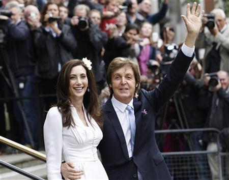 Singer Paul McCartney and his bride Nancy Shevell leave after their marriage ceremony at Old Marylebone Town Hall in London October 9, 2011.  REUTERS/Luke MacGregor