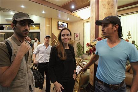 United Nations High Commissioner for Refugees (UNHCR) Goodwill Ambassador and actress Angelina Jolie (C) arrives at a hotel during a visit to Misrata October 11, 2011. REUTERS/Thaier al-Sudani
