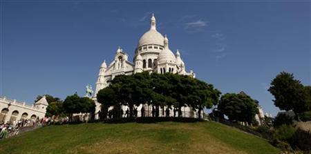The Sacre Coeur Basilica, one of Paris's tourist attractions, is seen on Montmartre in Paris on August 6, 2009. REUTERS/Benoit Tessier