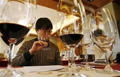 <p>A wine critic smells red wine during the Chateau Haut Brion wine-tasting event in Beijing, in this file picture taken April 18, 2007. REUTERS/Claro Cortes IV</p>