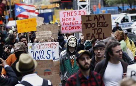 Members of the Occupy Wall Street movement take part in a protest march through the financial district of New York October 12, 2011.  REUTERS/Lucas Jackson