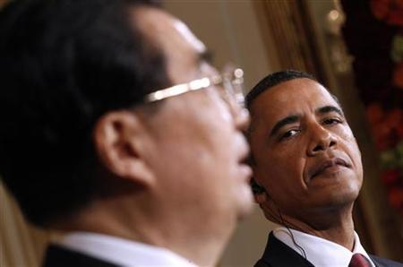 President Barack Obama looks on as Chinese President Hu Jintao speaks during a joint press conference in the East Room at the White House in Washington, January 19, 2011. REUTERS/Kevin Lamarque