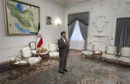 Iranian President Mahmoud Ahmadinejad waves to Qatar's Foreign Minister Adviser Khalid Mohammad al-Atiyeh (none pictured) before an official meeting in Tehran October 13, 2011. REUTERS/Morteza Nikoubazl