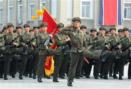 North Korean citizen's militia take part in a military parade in Pyongyang's central square in this photo taken by Kyodo on September 9, 2011 marking the 63rd anniversary of the state's founding. REUTERS/Kyodo