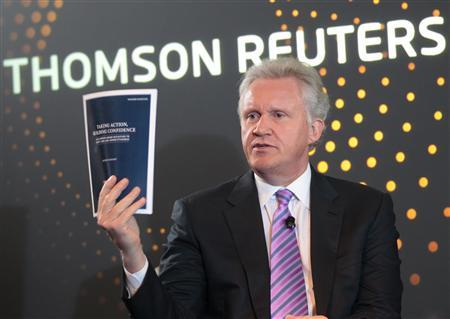 General Electric Co Chief Executive Jeff Immelt shows latest report from the President Barack Obama's Jobs Council: ''Taking Action, Building Confidence'' during a ThomsonReuters newsmaker event in New York, October 17, 2011. REUTERS/Brendan McDermid