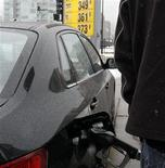 A motorist fills his tank at a gas station in a file photo. REUTERS/Frank Polich