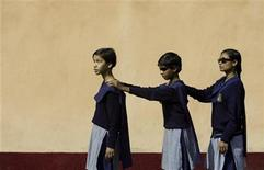 <p>Visually disabled children walk outside the auditorium during a cultural program on World Disabled Day at a school in the northeastern Indian city of Siliguri December 3, 2006. REUTERS/Rupak De Chowdhuri</p>