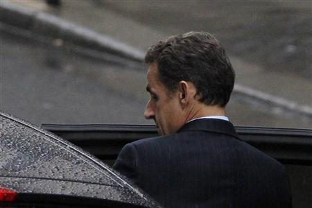 France's President Nicolas Sarkozy enters his car as he leaves the maternity clinic, Clinique de la Muette, in Paris, October 19, 2011. French media reports that his wife Carla Bruni-Sarkozy is at the clinic.   REUTERS/Gonzalo Fuentes