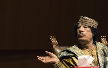 Libyan leader Muammar Gaddafi gestures as he attends a meeting with a businesswomen delegation in Rome in this June 12, 2009 file photo.  REUTERS/Alessandro Bianchi/Files