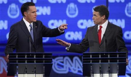 GOP presidential candidates former Massachusetts Governor Mitt Romney (L) and Texas Governor Rick Perry debate illegal immigration as they take part in the CNN Western Republican debate in Las Vegas, Nevada October 18, 2011.    REUTERS/Richard Brian