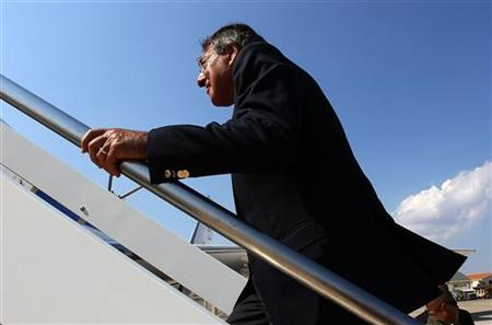 U.S. Defense Secretary Leon Panetta boards his plane after greeting personnel at the Sigonella Naval Air Station and NATO regional operations center in Sigonella October 7, 2011. REUTERS/Win McNamee/Pool