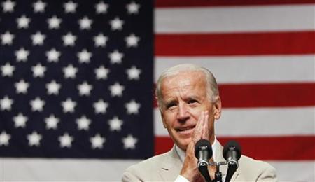 Vice President Joe Biden speaks to troops at Yokota Air Base on the outskirts of Tokyo August 24, 2011.  REUTERS/Toru Hanai