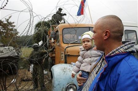 Kosovo Serbs resist Belgrade call to end impasse   Reuters
