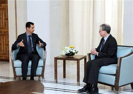 In this file picture, new U.S. ambassador Robert Ford (R) talks with Syria's President Bashar al-Assad after presenting his credentials to Assad, in Damascus January 27, 2011.  REUTERS/Sana