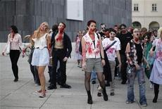 <p>People dressed as zombies take part in a flashmob in Vienna, September 27, 2011. REUTERS/Lisi Niesner</p>