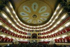 <p>Visitors walk in the main hall of Moscow's Bolshoi theatre October 24, 2011. REUTERS/Anton Golubev</p>