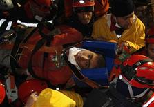 Rescue workers carry 18-year-old male survivor named Imdat from a collapsed building after surviving for more than 100 hours, in Ercis, near the eastern Turkish city of Van, October 27, 2011.  REUTERS/Osman Orsal