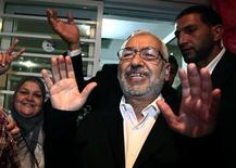 Rachid Ghannouchi, leader of the Islamist Ennahda movement,  gestures to supporters after the announcement of the country's election results outside his headquarters in Tunis October 27, 2011.  REUTERS/Zohra Bensemra