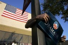 <p>A supporter holds a sign for Democratic presidential candidate Senator Barack Obama (D-IL) outside a rally in San Marcos, Texas February 27, 2008. REUTERS/Jessica Rinaldi</p>