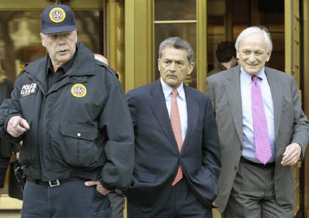 Rajat Gupta, (C) former Goldman Sachs director and global head of consultancy at McKinsey & Co., exits Manhattan Federal Court with his lawyer Gary Naftalis in New York October 26, 2011. REUTERS/Brendan McDermid
