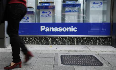 A woman walks past a show window displaying Panasonic Corp's DIGA Blu-ray and DVD recorders outside an electronics store in Tokyo October 31, 2011. REUTERS/Yuriko Nakao/Files