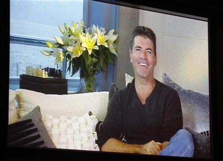 Simon Cowell, one of the judges on new reality series 'The X Factor' is shown on a large screen as he speaks via satellite from England, during a panel session at the FOX Summer TCA Press Tour in Beverly Hills, California August 5, 2011. REUTERS/Fred Prouser