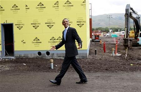 U.S. President Barack Obama passes by a construction site as he tours Solyndra, Inc., a solar panel manufacturing facility in Fremont, California May 26, 2010. REUTERS/Kevin Lamarque