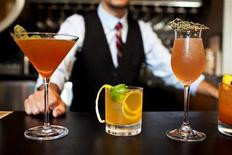 <p>A bartender at Holeman & Finch Public House in Atlanta, Georgia shows off an array of cocktail creations in this publicity photograph obtained on October 31, 2011. REUTERS/Beall & Thomas Photography/Handout</p>