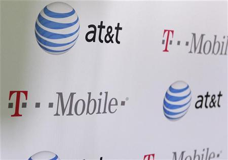 AT & T and T-Mobile logos are seen posted on the wall of a subway station at West 14th street and 8th avenue in New York September 27, 2011. The Metropolitan Transportation Authority today announced wireless voice and data communication capability for AT & T and T-Mobile users at six underground subway stations with Transit Wireless expecting to service the remaining 271 stations within four years. REUTERS/Shannon Stapleton (UNITED STATES - Tags: BUSINESS TELECOMS)