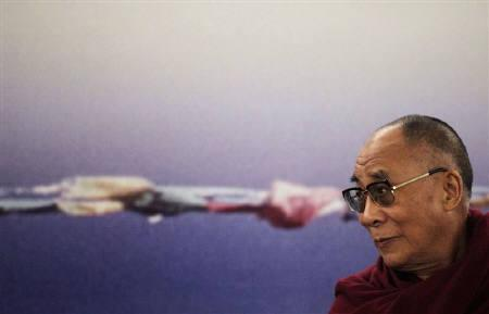 A file photo shows Tibet's exiled spiritual leader the Dalai Lama at a news conference in Sao Paulo September 16, 2011. China said on Tuesday that it had lodged a complaint with the Mongolian government about a visit to the vast and remote country by the Dalai Lama, who Beijing considers a dangerous separatist. REUTERS/Nacho Doce/Files