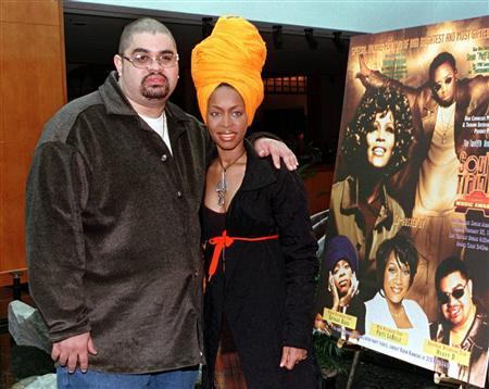 Hip-hop artist Heavy D (L) and singer Erykah Badu pose during a photo opportunity for the 12th annual Soul Train Music Awards in Beverly Hills in this January 28, 1998 file photo. REUTERS/Fred Prouser/Files