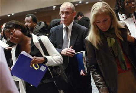 A man waits to speak with a job recruiter during a job fair in New York October 24, 2011.   REUTERS/Shannon Stapleton